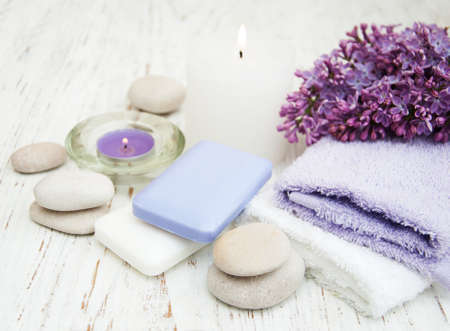 natural soap: Spa concept - natural soap, towels and lilac flowers