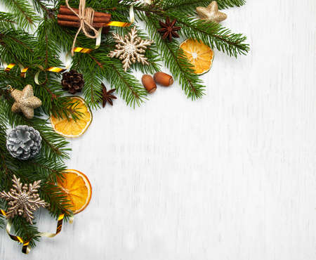 Christmas tree with baubles and dry oranges on a old wooden background Imagens
