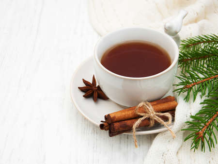 Cup of tea with christmas tree and scarf Stock Photo