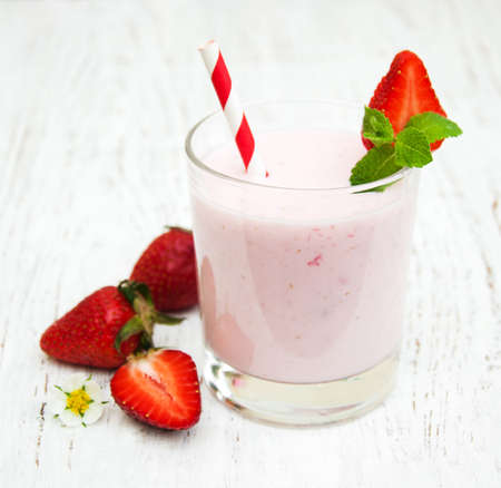 strawberry: Strawberry yogurt with fresh strawberries on a wooden background Stock Photo