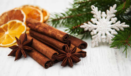 frutos secos: different kinds of spices  and dried oranges with christmas tree