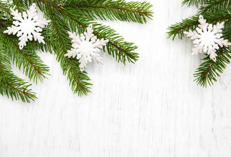 fir branch: christmas background - christmas decor on the wooden background Stock Photo