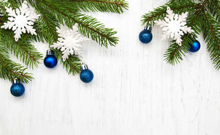 christmas decoration baubles and a branch of pine tree
