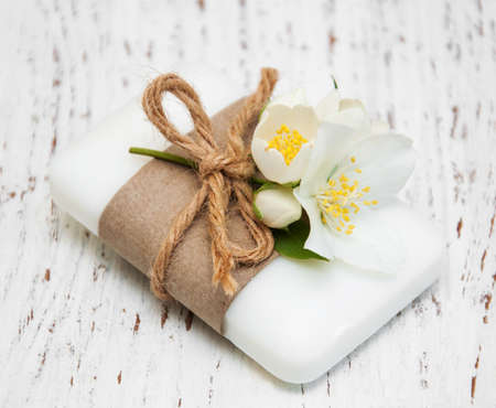 spa flower: soap with jasmine flower on a wooden background Stock Photo