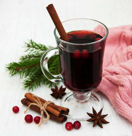 wine glasses: Glass of mulled wine with spices on a old wooden background