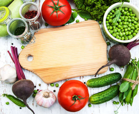 various vegetables on a old wooden background Imagens - 48010946