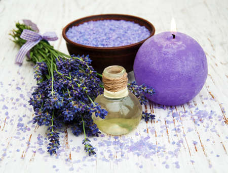 healthcare and beauty: Lavender, sea salt and candle on a wooden background Stock Photo