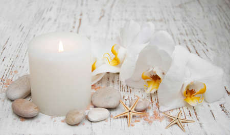 green orchid: White orchids, candle and salt on a wooden background