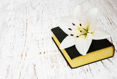 easter lily and bible on a old wooden background