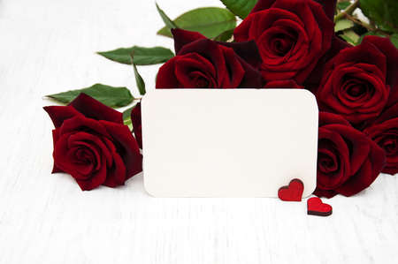 text space: Fresh Red roses background and greeting card