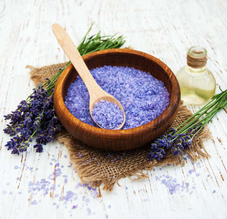 lavender oil with bath salt and fresh lavender on a old wooden background Reklamní fotografie