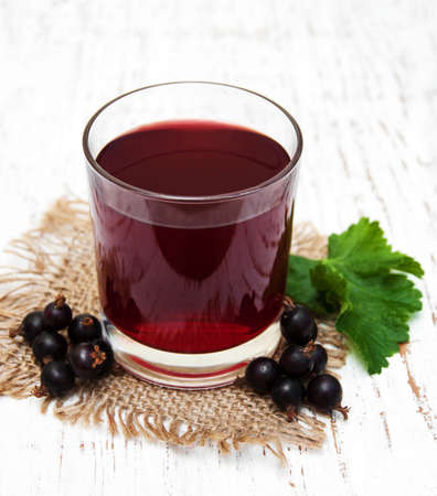 blackcurrant: Glass of blackcurrant lemonade on a old white wooden background Stock Photo