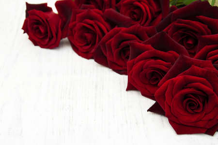 green background: Fresh Red roses on a old wooden background Stock Photo