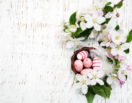 Nest with easter eggs and spring apple blossom