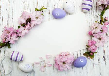 Easter greeting card with cherries blossom and eggs Standard-Bild