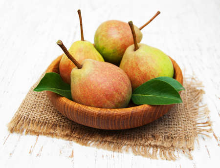 gunny: Fresh pears on a old wooden background