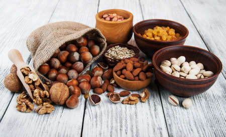different types of nuts on a old wooden table