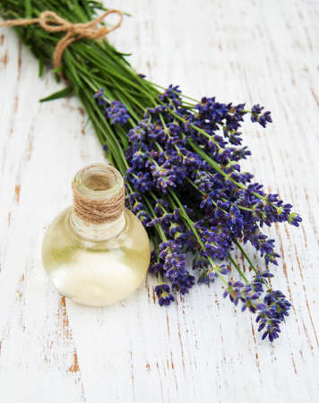 lavender oil: lavender oil with fresh lavender on a wooden background