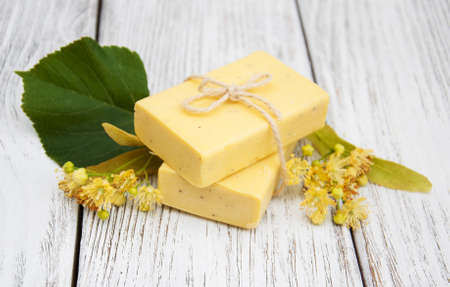 linden flowers: Handmade linden Soap with linden flowers on a old wooden table