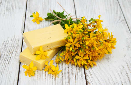 wort: St. Johns wort flowers and  handmade soap on the table