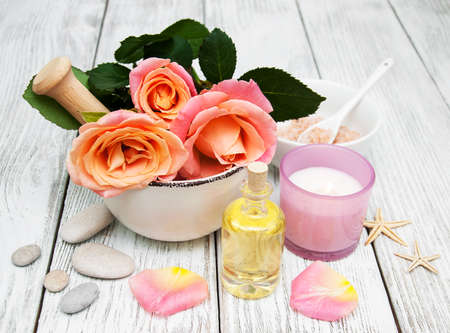 Spa concept with pink roses on a old wooden background 写真素材