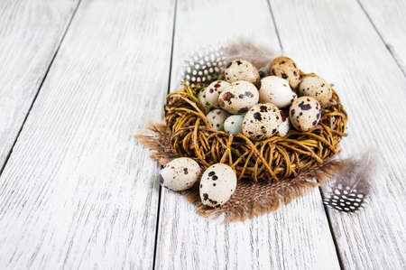 quail nest: quail eggs in nest on a old wooden table