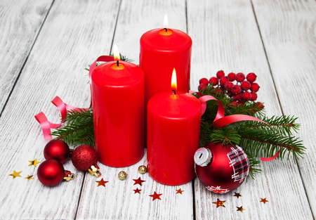 decorative christmas composition with red candles and pine
