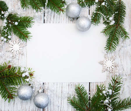 christmas background -  decorations  and fir branch on a wooden table