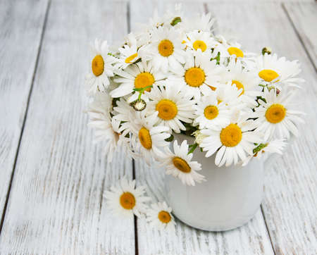 Daisies In Vase On A Old Wooden Table Stock Photo Picture And