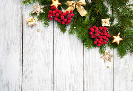 gold ornaments: christmas fir tree with decoration on a wooden board