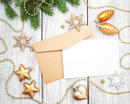 envelope decoration: Envelope with christmas decoration on a old wooden board