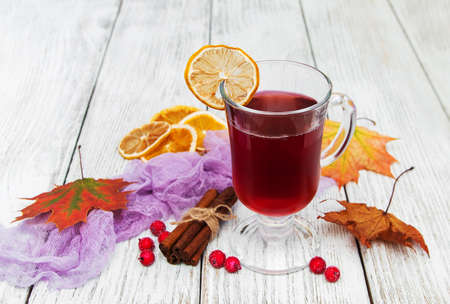 hot mulled wine with spices on a wooden background
