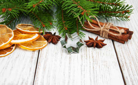 pastry cutters: baking concept  - spices for christmas cookie and green pine tree