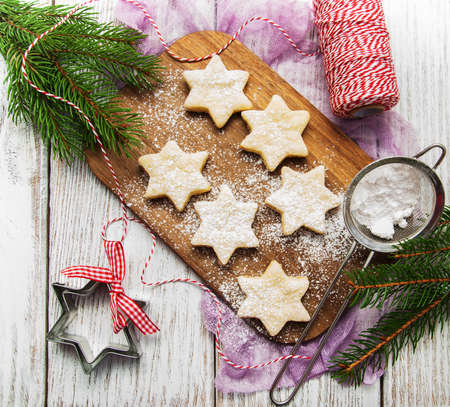 pastry cutters: Christmas cookies - fresh baked star shaped biscuits