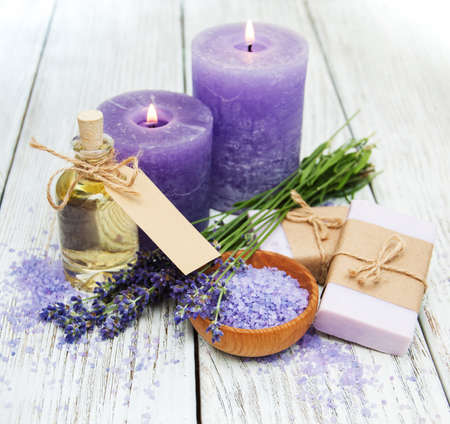 Lavender with soap on a wooden background