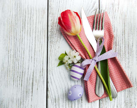 easter table setting with cherry blossoms  on a old wooden background Stock Photo