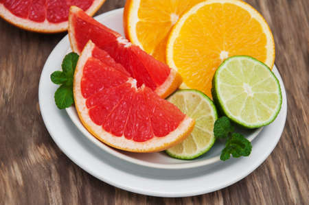 Fresh citrus fruits on a old wooden table Stock Photo