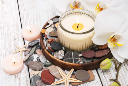 massage symbol: Spa products with white orchids flowers on a table