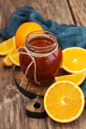 jams: Delicious orange jam on a old wooden table Stock Photo