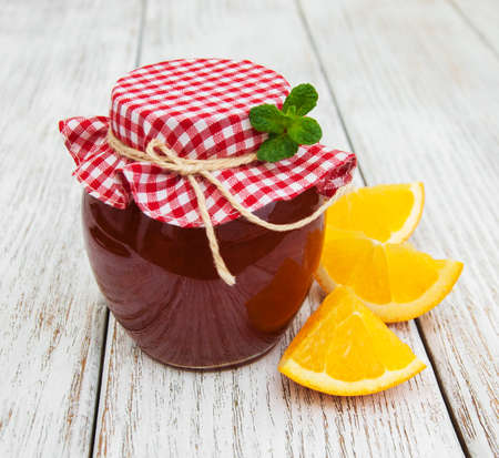 marmelade: Delicious orange jam on a old wooden table Stock Photo