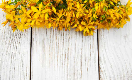 Saint-Johns-wort flowers  on a old wooden table