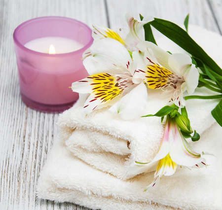 Spa composition with alstroemeria flowers on wooden background