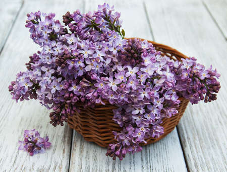 Lilac flowers on a old wooden background