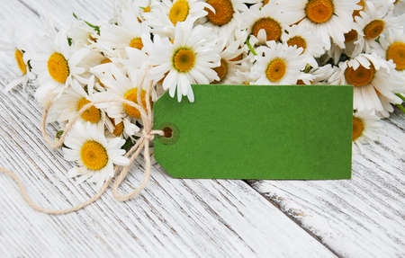 chamomile flower: bouquet of daisies  on a old wooden background Stock Photo