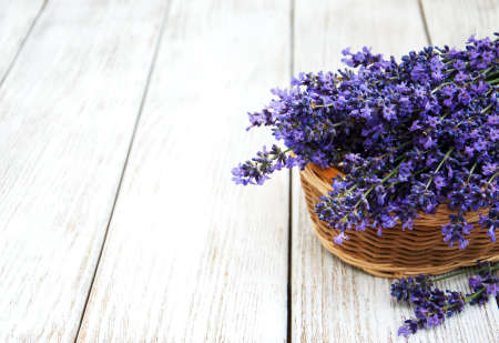 Basket with lavanda flowers on a old woode table
