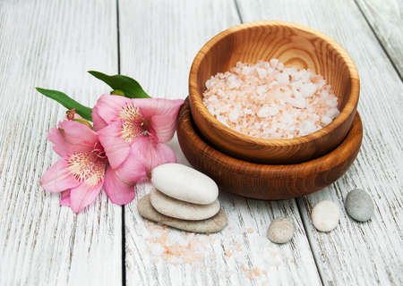 Spa composition with alstroemeria flowers on wooden table Stock Photo