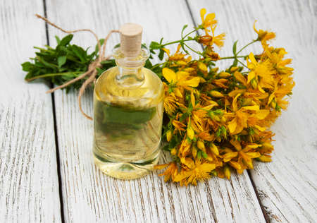 remedial: Bottle with St. Johns wort extract on the wooden table