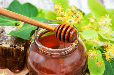 Honey and linden flowers Stock Photo