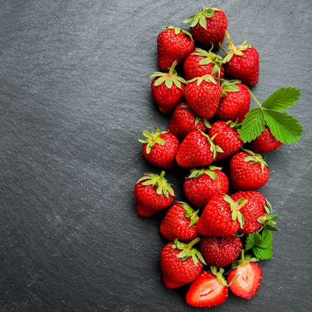 berry: Fresh strawberries on a black stone background