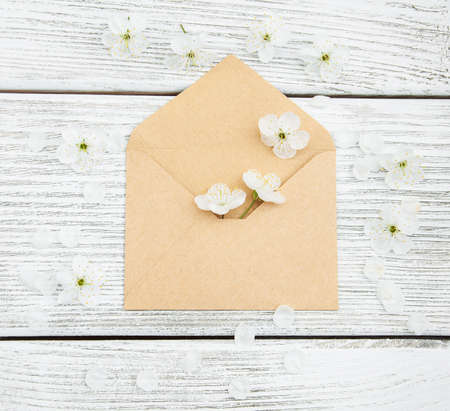 old envelope: flowers and envelope on a old wooden background Stock Photo